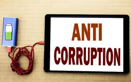 Hand writing text caption inspiration showing Anti Corruption. Business concept for Bribery Corrupt Text written on tablet laptop. With white textured Stock Photos
