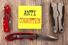 Hand writing text caption inspiration showing Anti Corruption. Business concept for Bribery Corrupt Text Written on sticky note wo. Hand writing text caption Stock Photography
