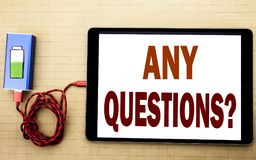Hand writing text caption inspiration showing Any Questions. Business concept for Answer Help Question written on tablet laptop wi. Th white textured background Stock Photo