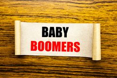 Hand writing text caption inspiration showing Baby Boomers. Business concept for Demographic Generation written on sticky note pap. Er on wooden background Royalty Free Stock Photo