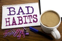Hand writing text caption inspiration showing Bad Habits. Business concept for Improvement Break Habitual Hebit written on note pa. Per on wooden background with Royalty Free Stock Photography