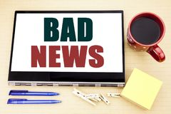 Hand writing text caption inspiration showing Bad News. Business concept for Failure Media Newspaper written on tablet laptop. Off. Hand writing text caption Stock Photos
