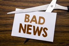Hand writing text caption inspiration showing Bad News. Business concept for Failure Media Newspaper Written on note, wooden back. Hand writing text caption Royalty Free Stock Photos