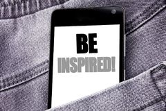 Hand writing text caption inspiration showing Be Inspired. Business concept for Inspiration, Motivation written mobile cell phone. With space in the back pants Stock Photography