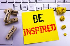 Hand writing text caption inspiration showing Be Inspired. Business concept for Inspiration and Motivation written on sticky note. Hand writing text caption Stock Photos