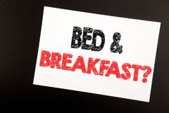 Hand writing text caption inspiration showing Bed Breakfast. Business concept for Holiday Journey Travel written on sticky note,. Black background copy space royalty free stock image