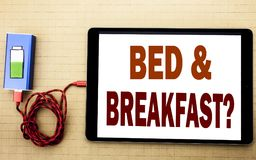 Hand writing text caption inspiration showing Bed Breakfast. Business concept for Holiday Journey Travel written on tablet laptop. With white textured stock photo