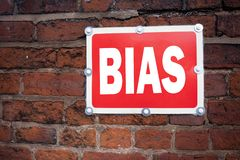 Hand writing text caption inspiration showing Bias concept meaning Prejudice Biased Unfair Treatment written on old announcement r. Oad sign with background and Royalty Free Stock Photos