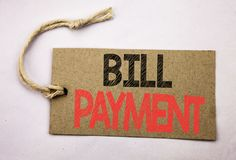 Hand writing text caption inspiration showing Bill Payment. Business concept for Billing Pay Costs written on price tag paper on t. Hand writing text caption Royalty Free Stock Images