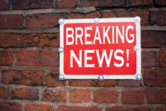 Hand writing text caption inspiration showing Breaking News concept meaning Newspaper Breaking News written on old announcement ro. Ad sign with background and Stock Photo