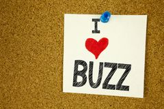 Hand writing text caption inspiration showing Buzz concept meaning Buzz Word llustration and Love written on sticky note, reminder. Background with space stock photo