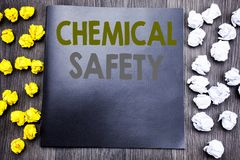 Hand writing text caption inspiration showing Chemical Safety. Business concept for Hazard Health At Work Written on notepad note. Notebook wooden background stock photos