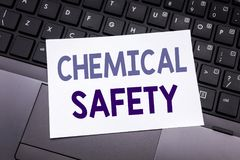 Hand writing text caption inspiration showing Chemical Safety. Business concept for Hazard Health At Work written on sticky note p. Aper on black keyboard royalty free stock image