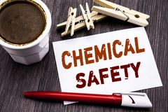 Hand writing text caption inspiration showing Chemical Safety. Business concept for Hazard Health At Work written on sticky note p. Aper on wooden wood Royalty Free Stock Image