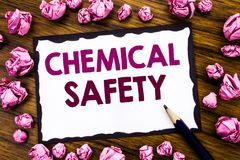 Hand writing text caption inspiration showing Chemical Safety. Business concept for Hazard Health At Work Written on sticky note p. Aper, wooden background Royalty Free Stock Image