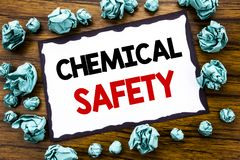 Hand writing text caption inspiration showing Chemical Safety. Business concept for Hazard Health At Work Written on sticky note p. Aper, wooden background Stock Image