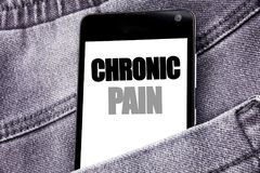 Hand writing text caption inspiration showing Chronic Pain. Business concept for Feeling Bad ill Care written mobile cell phone wi stock photography
