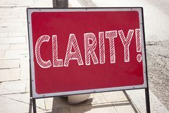 Hand writing text caption inspiration showing Clarity concept meaning Clarity Message written on old announcement road sign with b Royalty Free Stock Image