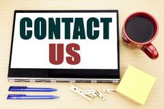 Hand writing text caption inspiration showing Contact Us. Business concept for Customer Support written on tablet laptop. Office p. Hand writing text caption stock images