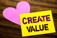 Hand writing text caption inspiration showing Create Value. Business concept for Creating Motivation written on sticky note paper,. Wooden background. With pink royalty free stock photos