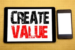 Hand writing text caption inspiration showing Create Value. Business concept for Creating Motivation Written on tablet laptop, woo. Hand writing text caption Stock Photo