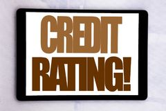 Hand writing text caption inspiration showing Credit Rating. Business concept for Finance Score History written on tablet screen o. N white background stock image