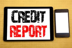Hand writing text caption inspiration showing Credit Report. Business concept for Finance Score Check Written on tablet laptop, wo. Hand writing text caption Royalty Free Stock Images