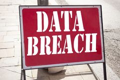 Hand writing text caption inspiration showing Data Breach concept meaning Tech Internet Network Breaking into Database written on Royalty Free Stock Photography