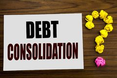 Hand writing text caption inspiration showing Debt Consolidation. Business concept for Money Loan Credit written on white note pap. Hand writing text caption Stock Photography