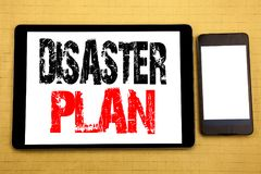 Hand writing text caption inspiration showing Disaster Plan. Business concept for Emergency Recovery Written on tablet laptop, woo. Hand writing text caption Royalty Free Stock Image