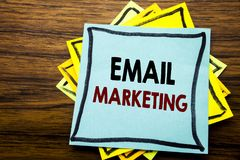 Hand writing text caption inspiration showing Email Marketing. Business concept for Online Web Promotion written on sticky note pa. Per on wooden wood background Royalty Free Stock Images