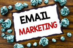 Hand writing text caption inspiration showing Email Marketing. Business concept for Online Web Promotion Written on sticky note pa. Per, wooden background folded Stock Photos
