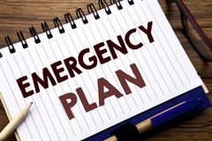 Hand writing text caption inspiration showing Emergency Plan. Business concept for Disaster Protection Written on notebook note pa. Hand writing text caption Stock Photos