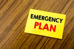 Hand writing text caption inspiration showing Emergency Plan. Business concept for Disaster Protection written on sticky note pape. R on wooden keyboard Royalty Free Stock Images