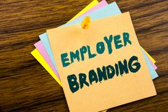 Hand writing text caption inspiration showing Employer Branding. Business concept for Brand Building written on sticky note paper. On wooden background stock images