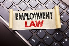 Hand writing text caption inspiration showing Employment Law. Business concept for Employee Legal Justice written on sticky note p. Aper on dark keyboard Royalty Free Stock Photography