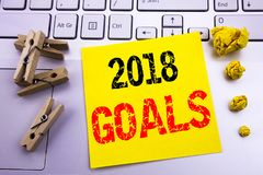 Hand writing text caption inspiration showing 2018 Goals. Business concept for financial planning, business strategy written on st. Icky paper on the white Stock Photos