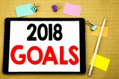 Hand writing text caption inspiration showing 2018 Goals. Business concept for financial planning, business strategy Written on ta. Blet, wooden background with Stock Photography