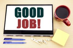Hand writing text caption inspiration showing Good Job. Business concept for Success Appreciation written on tablet laptop. Office. Hand writing text caption stock photo