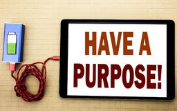 Hand writing text caption inspiration showing Have A Purpose. Business concept for Dreams Choose Vision written on tablet laptop w Royalty Free Stock Photography