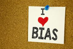 Hand writing text caption inspiration showing I Love Bias concept meaning Prejudice Biased Unfair Treatment Loving written on stic. Ky note, reminder isolated Stock Image