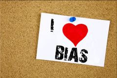 Hand writing text caption inspiration showing I Love Bias concept meaning Prejudice Biased Unfair Treatment Loving written on stic. Ky note, reminder isolated Stock Photos