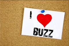 Hand writing text caption inspiration showing I Love Buzz concept meaning Buzz Word llustration Loving written on sticky note, rem. Inder isolated background stock photo