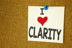 Hand writing text caption inspiration showing I Love Clarity concept meaning Clarity Message Loving written on sticky note, remind. Er  background with space Royalty Free Stock Image