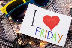 Hand writing text caption inspiration showing I Love Friday concept meaning Friday - happy end of the week Loving written on stick. Y note, reminder text space Stock Photography