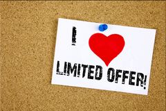 Hand writing text caption inspiration showing I Love Limited Offer concept meaning Limited Time Sale Loving written on sticky note. Reminder isolated background Royalty Free Stock Image