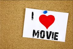 Hand writing text caption inspiration showing I Love Movie concept meaning Entertainment Movie Film Loving written on sticky note, Stock Photography