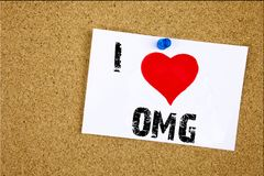 Hand writing text caption inspiration showing I Love OMG Oh My God concept meaning Surprise Humor Loving written on sticky note, r Royalty Free Stock Images