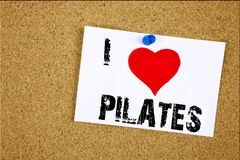 Hand writing text caption inspiration showing I Love Pilates concept meaning Fitness Balance Workout Exercise Loving written on st Stock Photos