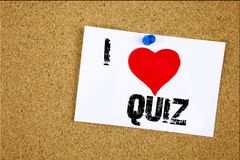 Hand writing text caption inspiration showing I Love Quiz concept meaning Test education Exam Concept Loving written on sticky not. E, reminder isolated stock photography